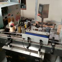 Automatic round bottle self-adhesive labelling machine (Used)